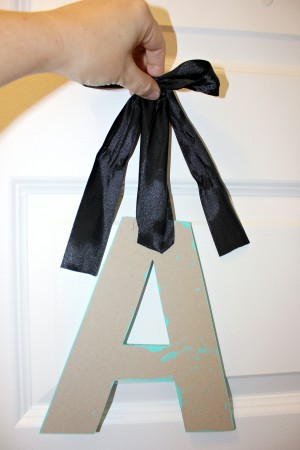 Adding ribbon to wooden letter monogram