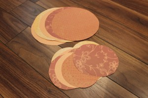 Orange scrapbook paper circles for paper pumpkin craft